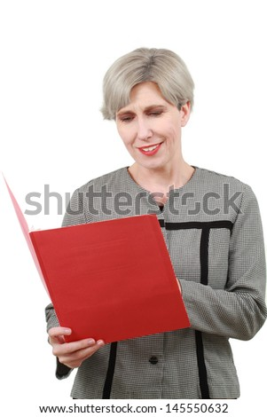 Woman reads from a folder - stock photo