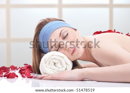 Woman ready for massage at beauty spa. - stock photo