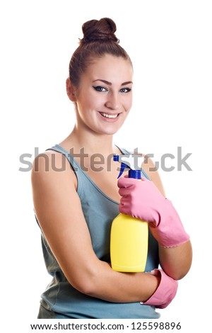 Woman ready for spring cleaning smiling with rubber gloves and cleaning products. Pretty smiling young caucasian girl isolated on white background.