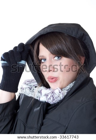 Woman ready for winter; isolated on a white background - stock photo