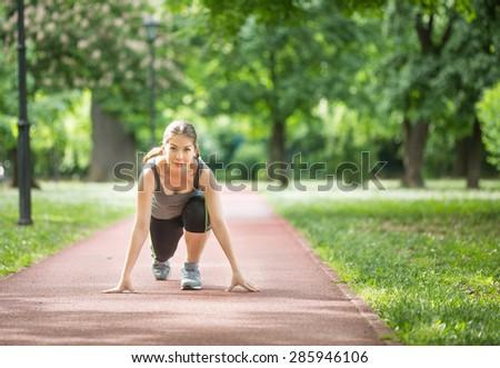 woman ready to run - stock photo