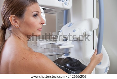 Woman ready to undergo mammography scan. - stock photo