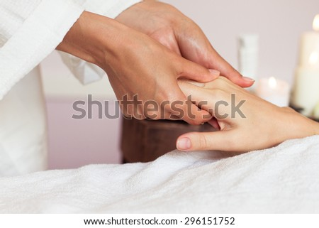 Woman receiving a hand massage at the health spa. Clpse-up - stock photo