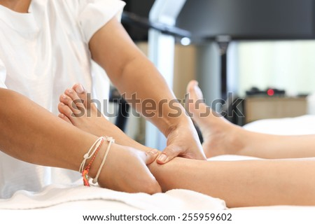 woman receiving and relaxing foot massage at the health spa - stock photo