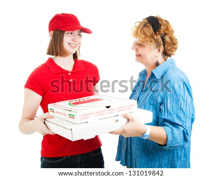 Woman receiving delivery of fresh hot pizza from a teenage delivery girl.  Isolated on white. - stock photo