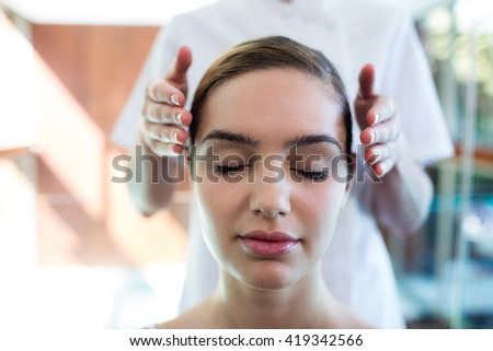 Woman receiving massage from masseur at spa - stock photo