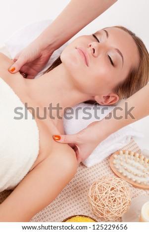 woman receiving shoulders massage in spa salon - stock photo