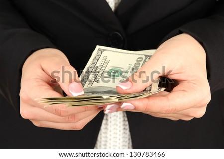 Woman recounts dollars, close up - stock photo