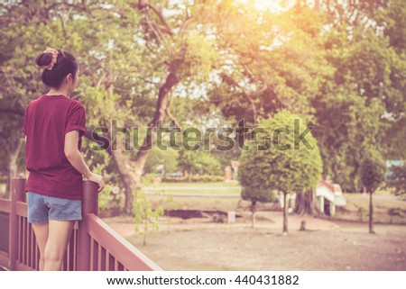 Woman relax enjoying nature at the park.