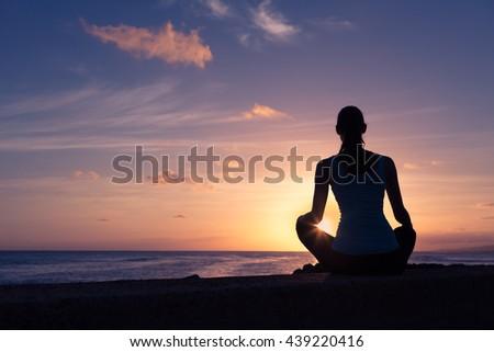 Woman relaxing and enjoying the beautiful sunset view.  - stock photo