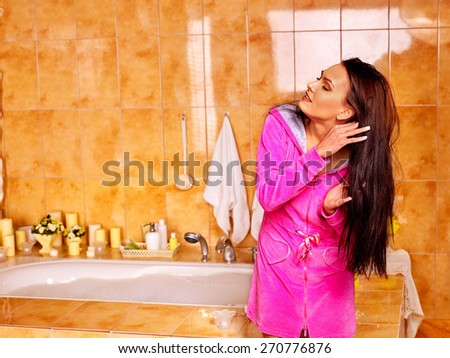 Woman relaxing at home luxury bath. Brush hair. - stock photo