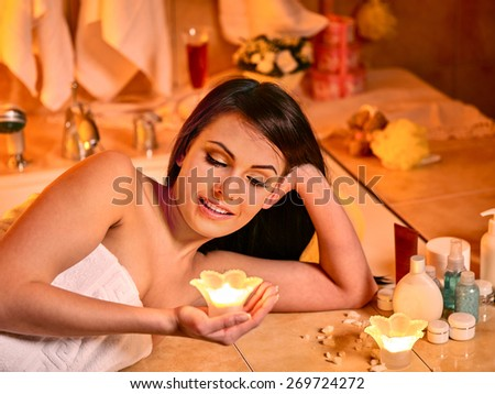 Woman relaxing at home luxury bath. Burning candles - stock photo