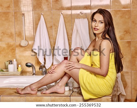 Woman relaxing at home luxury bath. Girl sitting on  edge - stock photo