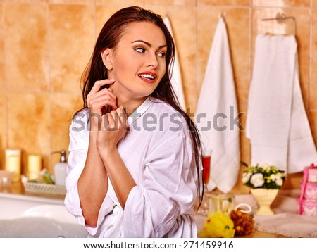 Woman relaxing at home luxury bath. Towel background. - stock photo