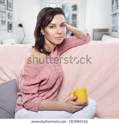 woman relaxing at home with coffee - stock photo