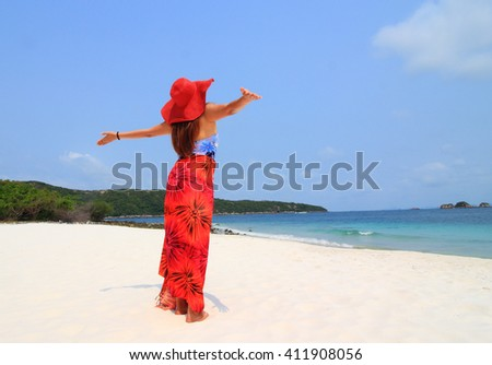 Woman relaxing at the beach with arms open enjoying her freedom ,Vacation Start Here Concept, - stock photo
