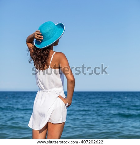 Woman relaxing at the seaside. - stock photo