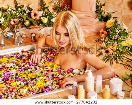 Woman relaxing at water spa. Looking down - stock photo