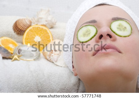 Woman relaxing in bathroom - stock photo