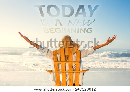 Woman relaxing in deck chair by the sea against today is a new beginning - stock photo