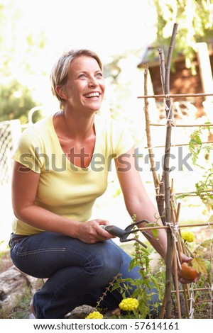 Woman Relaxing In Garden - stock photo