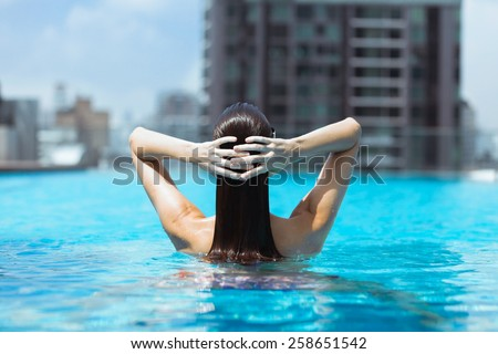 Woman relaxing in luxury resort - stock photo