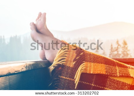 Woman relaxing in mountains - stock photo