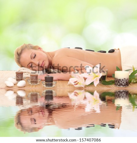 woman relaxing in spa - stock photo