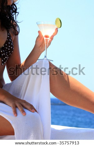 woman relaxing in the afternoon by the sea in Greece - stock photo