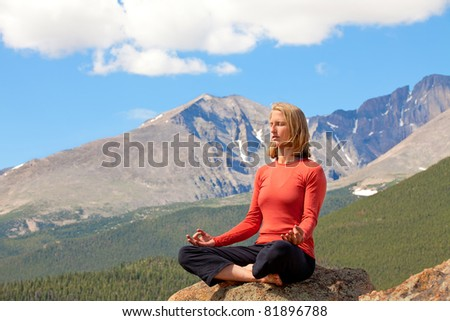 Woman relaxing in the mountains - stock photo