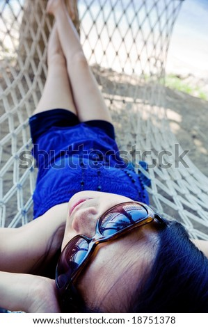 woman relaxing on hammock in caricature angle - stock photo