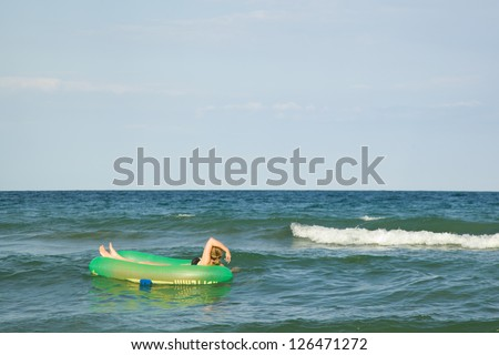 Woman relaxing on the inflatable