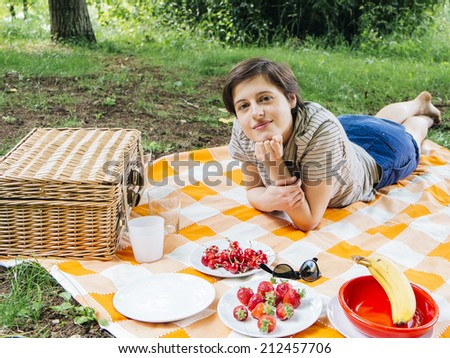 woman relaxing outdoor and having a picnic - stock photo