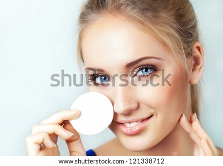Woman removing applyed makeup - stock photo