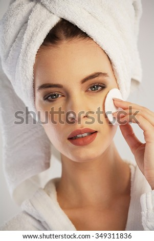 Woman removing her make-up - stock photo