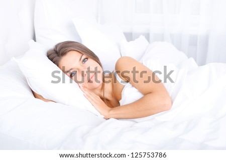 Woman resting in bed - stock photo