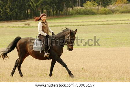 Woman rides on a horse.