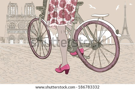 woman riding a bicycle in Paris. Raster version  - stock photo