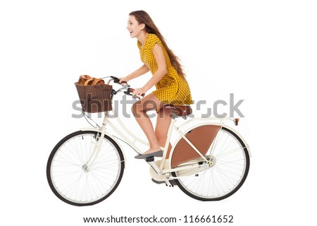 Woman riding a bike - stock photo