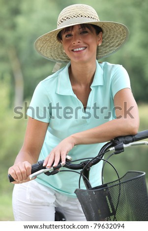 Woman riding bike - stock photo