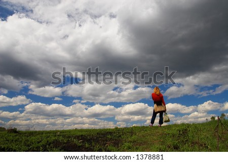 Woman, road and clouds. Sibir. Russia. - stock photo