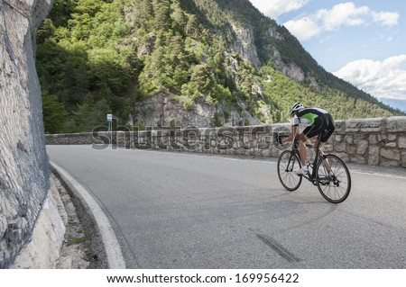 woman road cycling - stock photo