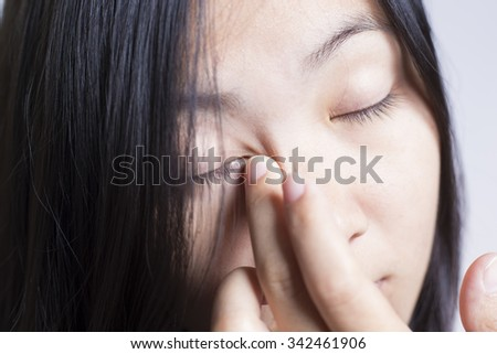 Woman Rubbing Her Eye - stock photo