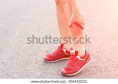 woman runner leg and muscle pain on  road in morning  - stock photo