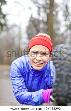 Woman runner stretching and exercising in winter forest - stock photo