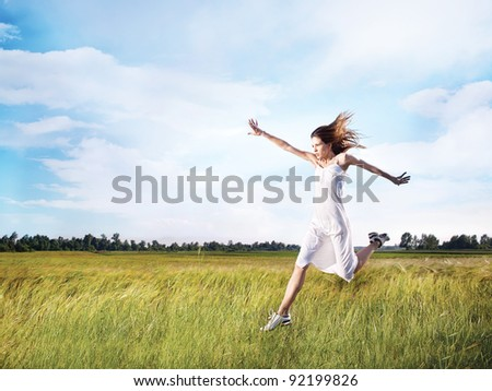 woman running across field - stock photo