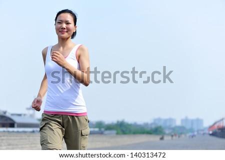 woman running at xian city wall in china - stock photo