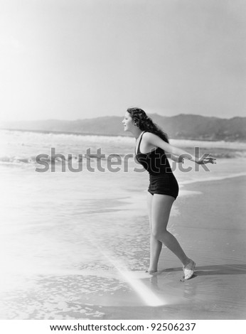 Woman running into the water at the beach