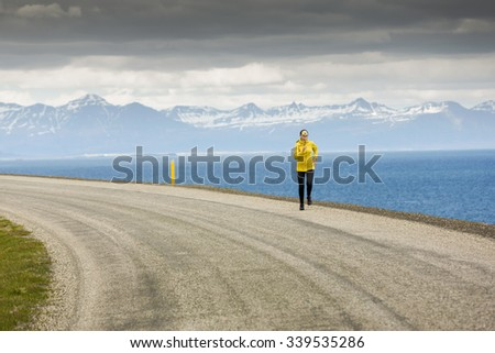 Woman running on a winter day - stock photo