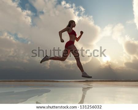 Woman running on the beach - stock photo